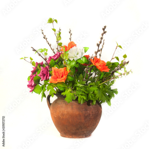 Bouquet in an old jug. Isolated on a white background