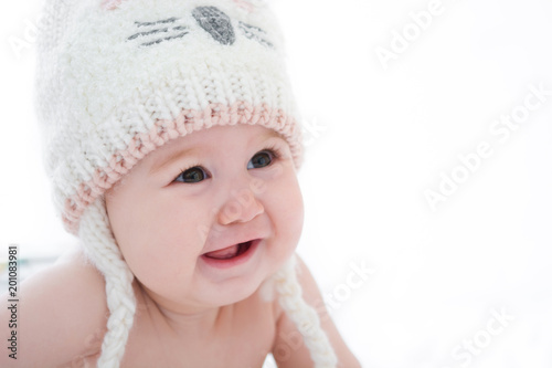Adorable little baby girl smiling on white background. Copyspace
