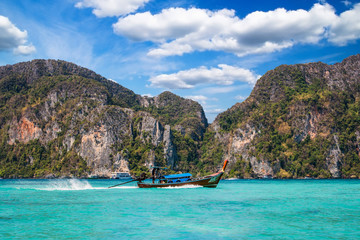 Traditional thai long tail boat in the bay of Phi Phi Island (Ko Phi Phi), Thailand