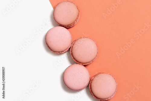 Plexiglas Macarons Flat lay of orange macaroons pattern on pastel background with copy space. Almond cookies as decoration. Minimal concept.