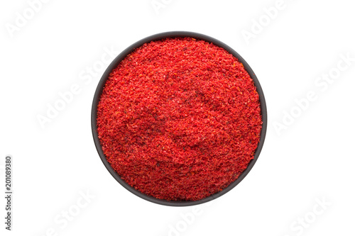 Plexiglas Hot chili peppers chili pepper powder in clay bowl isolated on white background. Seasoning or spice top view