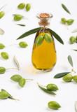 Bottle of olive oil and green olives.