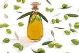 Green olives and bottle of olive oil.