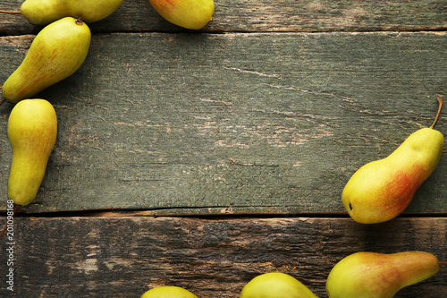 Ripe and sweet pears on grey wooden table - 201098168