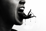 A persons tongue filled with black - 201111953
