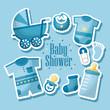 happy baby shower born boy celebration blue clothes bib baby pacifier  pram  toe sock vector illustration