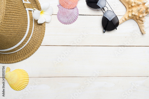 summer beach accessories on wood