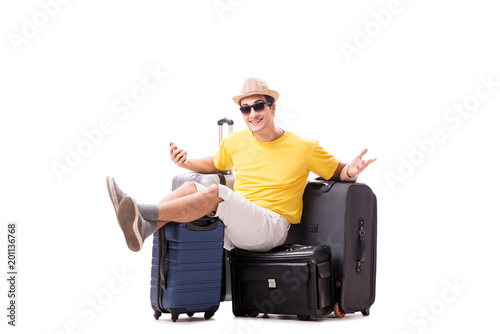 Foto Murales Happy young man going on summer vacation isolated on white