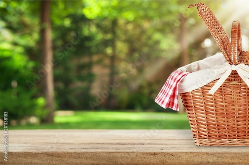 Picnic Basket with napkin on nature background - 201138183