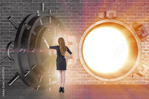 Businessman in front of banking vault door - 201139126