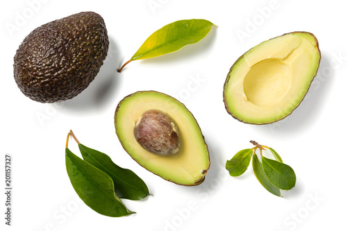 Slices of avocado on white background. Whole and half with leaves. Design element for product label - 201157327