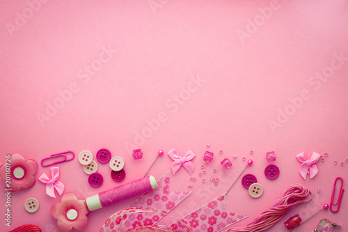 Sewing tool or craft tool on a pink background , top view or overhead shot with copy space