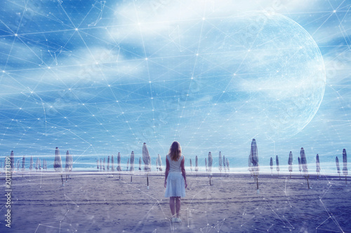 Woman stands on beach with abstract cyberspace network background