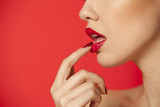 red glossy lipstick on red background - 201173301