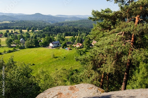 Summer landscape with forests, meadows rocks and sky