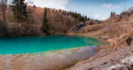 Beautiful blue mountain lake. The Blue Colour is caused by former limestone mining. (Blauer See, Hüttenrode near Blankenburg, National Park Harz in Germany