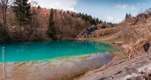 Foto Murales Beautiful blue mountain lake. The Blue Colour is caused by former limestone mining. (Blauer See, Hüttenrode near Blankenburg, National Park Harz in Germany