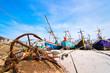 Quadro Fishing boats aground on the beach over cloudy sky at Prachuap Khiri Khan, Thailand.