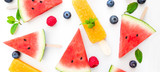 Summer patterm-  Watermelon slice  popsicle  and berries  on white background. Flat lay, top view.