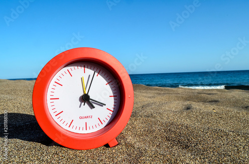 Photo Picture of a Clock on the Sand Beach - 201188100