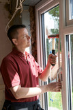Construction Worker Installing New Windows In House - 201189754