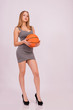 Beautiful girl in short dress with ball.