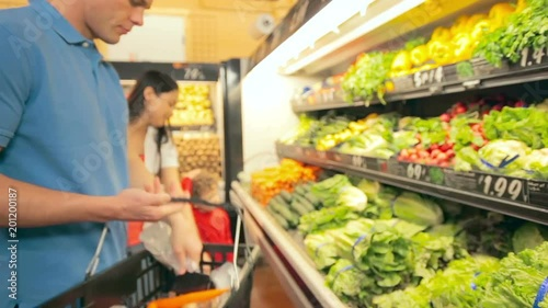 Young family shop for fresh vegetables together