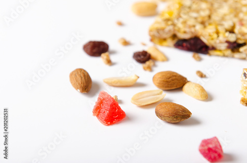 Mix of nuts, dried fruits, raisins on white background