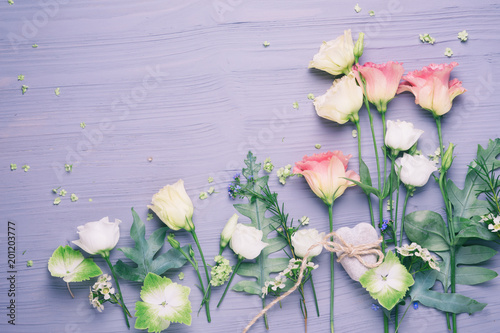 Wall mural Flowers and stone heart on wooden background  --  Flat lay  -  Mothers day, Marriage