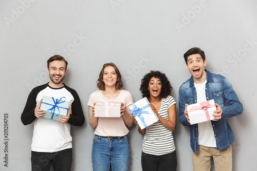 Excited group of friends holding surprise gift boxes.