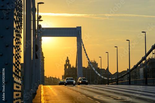 Cars on Elisabeth bridge in Budapest, sunrise