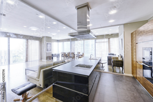 Modern interior in a new luxury house with panoramic windows.