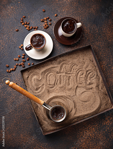 Wall mural Traditional turkish coffee prepared on hot sand