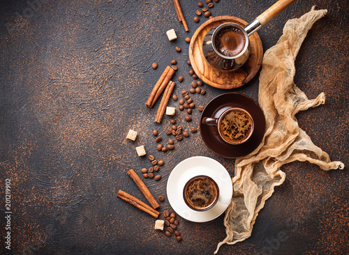 Foto Murales Cups of coffee, beans, sugar and cinnamon