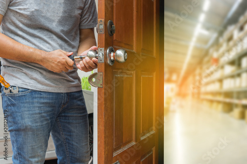 locksmith open the wood door to warehouse furniture