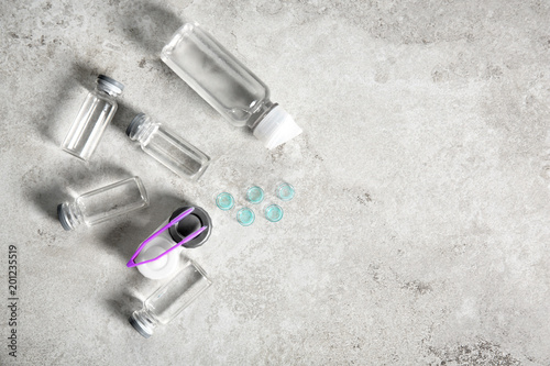 Contact lenses and accessories on light background, top view © New Africa