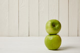 Two raw fresh green apples on wooden background with copy space - 201241381