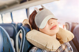 Womang in sleep mask and with pillow travelling in bus - 201243349