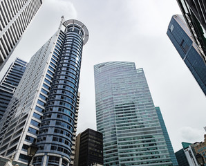 Bottom view of blue skyscrapers in the Raffles Place, Central Business District of Singapore