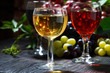 glasses of wine on dark wooden table, closeup