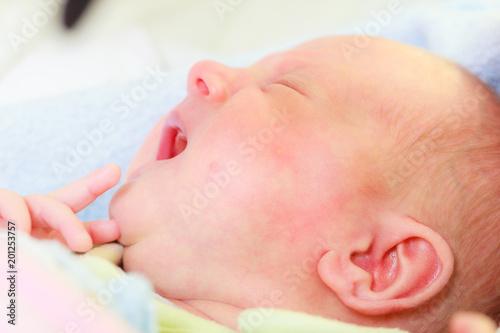 Little newborn sad baby crying