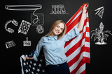 USA flag. Cheerful smart hardworking student feeling proud and confident while holding a big American flag after moving to the USA - 201265554