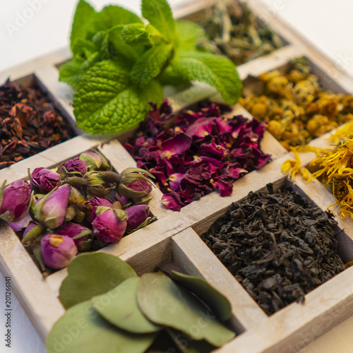 collection of herbal teas in a wooden vintage box