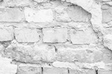 Texture of a white ruined brick wall