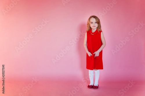 Little cute sweet smiling girl in red dress standing on pink colourful pastel trendy modern fashion pin-up background - 201271541