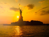 The Statue of Liberty in New York City at sunset - 201285998