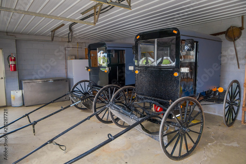 Foto Murales Indoor view of Amish black carriage or buggy parked inside of a garage of a house in Lancaster County