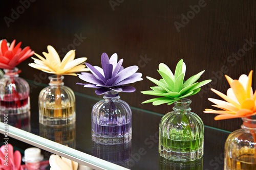 Flowers in jars with fragrant oils
