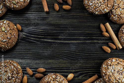 Sticker Homemade cookies with seeds and nuts on dark wooden background