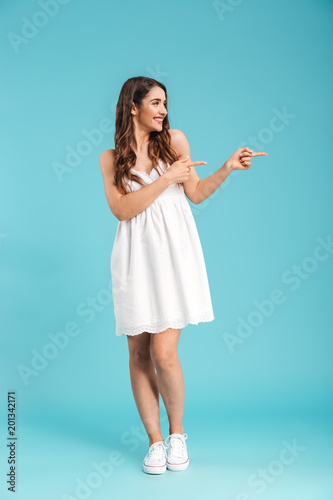 Full length portrait of a young girl in summer dress